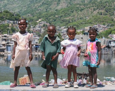 Young children by the river in Cap-Haitien. Photo: Alex Proimos