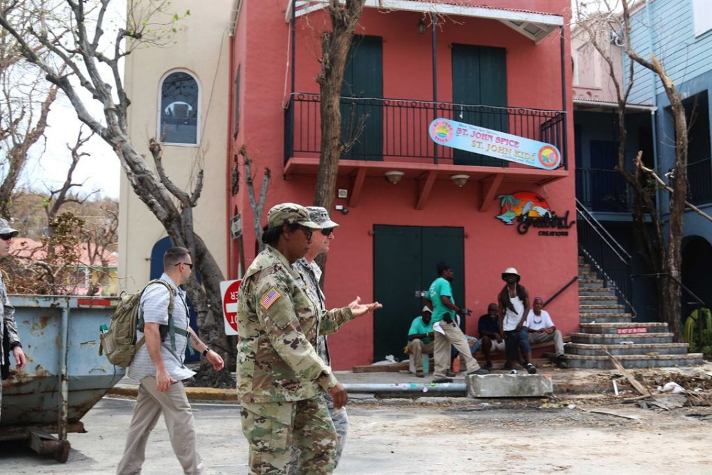 Troops assess the damage on Saint John while locals go about their day. Source: U.S. Department of Defense