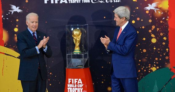 Vice_President_Joe_Biden_and_Secretary_of_State_John_Kerry_applaud_the_FIFA_World_Cup_trophy_at_the_U.S._Department_of_State