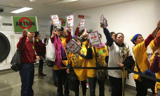 Voters stand in protest of legislation that aims to expand rent control in California outside a legislative hearing in Sacramento, Calif., on Thursday, Jan. 11, 2018. Kathleen Ronayne, Associated Press. (AP Photo/Kathleen Ronayne)