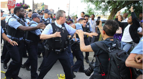 Chicago police officers scuffle with angry protestors where Harith Augustus was killed, July 14, 2018. Image Source: Nuccio DiNuzzo / Chicago Tribune