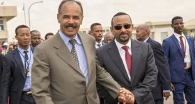 Ethiopia Prime Minister Abiy Ahmed (right) and Eritrean President Isaias Afwerki (left) holding hands. Source: Ghideon Musa Aron Visafric / Reuters