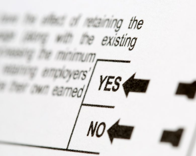 Selective focus on Yes or No voting choices for a proposition on a United States voting ballot