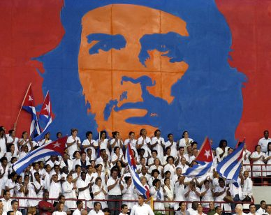 Young Cuban doctors take part in the graduation ceremony of thousands of new professionals from the whole country 19 September, 2005 in Havana. The Henry Reeve international brigade of 3.386 physicians specialized in disasters and epidemics was officially created in Havana on Monday, and among them are the 1.586 doctors whose help Cuba offered to the United States after the catastrophic passage of hurricane Katrina, Castro said.    AFP PHOTO/Antonio LEVI